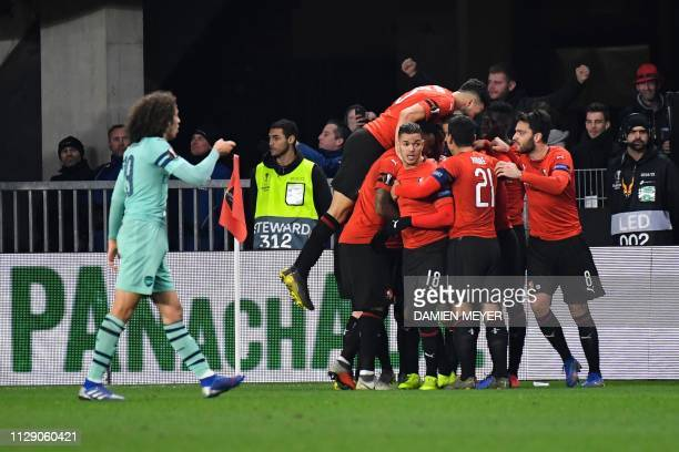 Rennes' players celebrate their second goal during the UEFA Europa League round of 16 first leg football match between Stade Rennais FC and Arsenal...