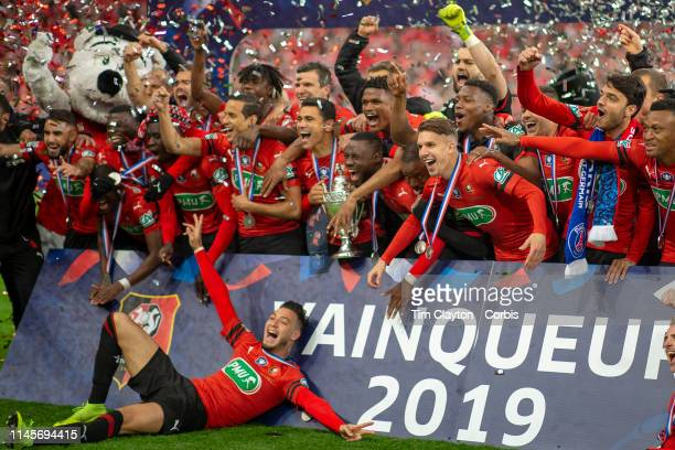 Rennes players celebrate with the trophy after their dramatic penalty shoot out win during the Rennes V Paris SaintGermain Coupe de France Final at...