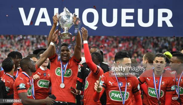 Rennes' players celebrate with the trophy after winning the French Cup final football match between Rennes and Paris Saint-Germain , on April 27,...