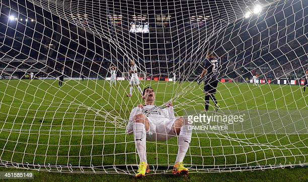 Rennes' Portuguese forward Nelson Oliveira hanging the goal's net reacts after missing a goal during the French L1 football match Rennes against...