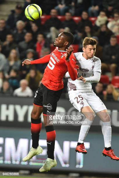 Rennes' Senegalese forward Diafra Sakho vies with Rennes' Portuguese defender Afonso Figueiredo during the French L1 football match between Rennes...