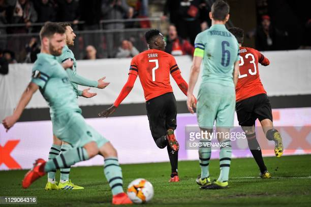 Rennes' Senegalese forward Ismaila Sarr celebrates after scoring their third goal during the UEFA Europa League round of 16 first leg football match...