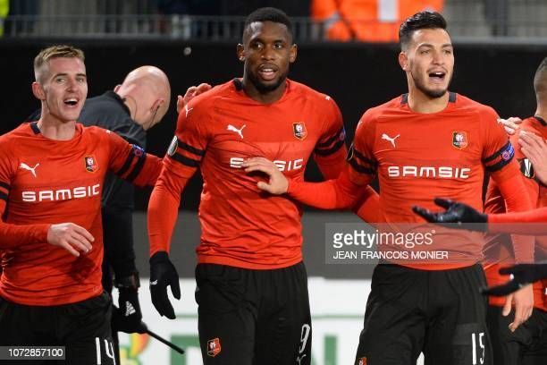 Rennes' Senegalese forward Ismaila Sarr celebrates with Rennes' French midfielder Benjamin Bourigeaud and Rennes' Algerian defender Rami Bensebaini...