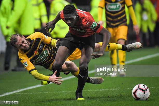 Rennes' Senegalese forward Ismaila Sarr fights for the ball with Orleans' Yohan Demoncy during the French Cup quarterfinal football match between...