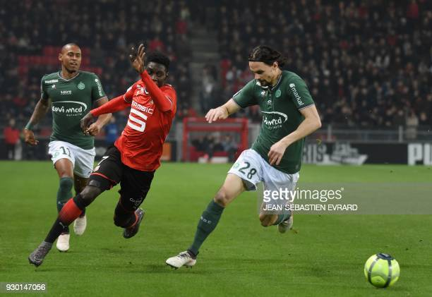 Rennes' Senegalese forward Ismaila Sarr fights for the ball with SaintEtienne's Serbian defender Neven Subotic during the French L1 football match...