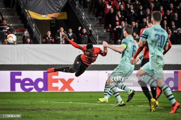 Rennes' Senegalese forward Ismaila Sarr heads to score their third goal during the UEFA Europa League round of 16 first leg football match between...