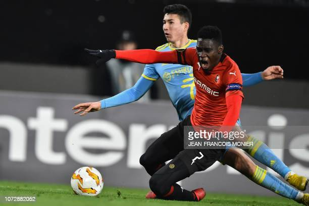 Rennes' Senegalese forward Ismaila Sarr vies with Astana's Kazakh forward Baktiyor Zaynutdinov during the UEFA Europa League Group K football match...