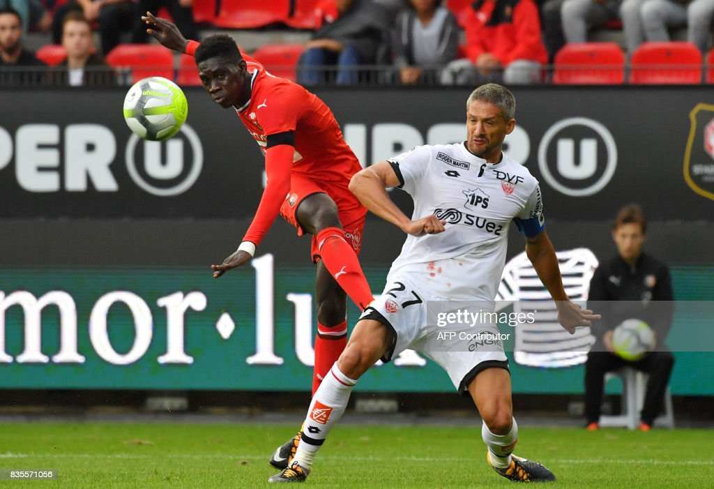 Rennes' Senegalese forward Ismaila Sarr (L) vies with Dijon's French defender Cedric Varrault during the French L1 football match between Rennes (SRFC) and Dijon (DFCO) at the Roazhon Park stadium in Rennes, western France, on August 19, 2017. /