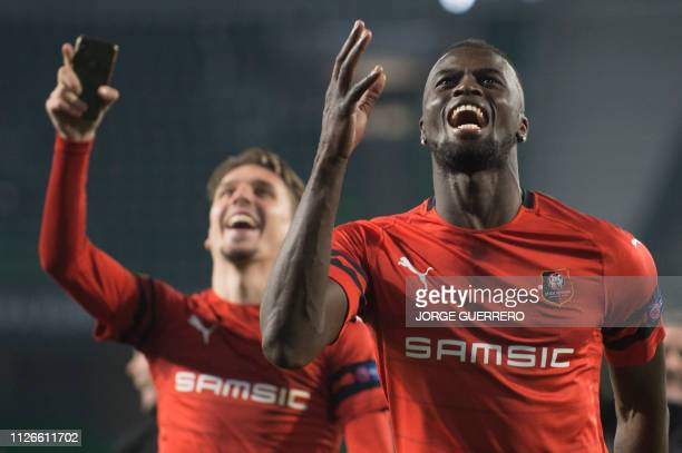 Rennes' Senegalese forward Mbaye Niang celebrate after winning the UEFA Europa League round of 32 second leg football match between Real Betis and...