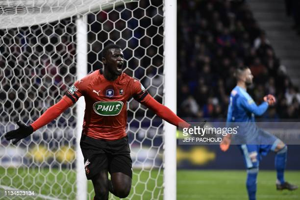 Rennes' Senegalese forward M'Baye Niang celebrates after scoring a goal during the French Cup semifinal football match between Lyon and Rennes at the...