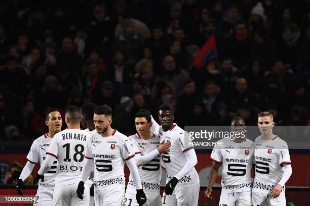 Rennes' Senegalese forward Mbaye Niang celebrates with teammates after scoring a goal during the French L1 football match between Paris SaintGermain...