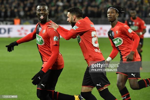Rennes' Senegalese forward Mbaye Niang is congratuled by teamates Rennes' French forward Romain Del Castillo and Rennes' French midfielder Eduardo...