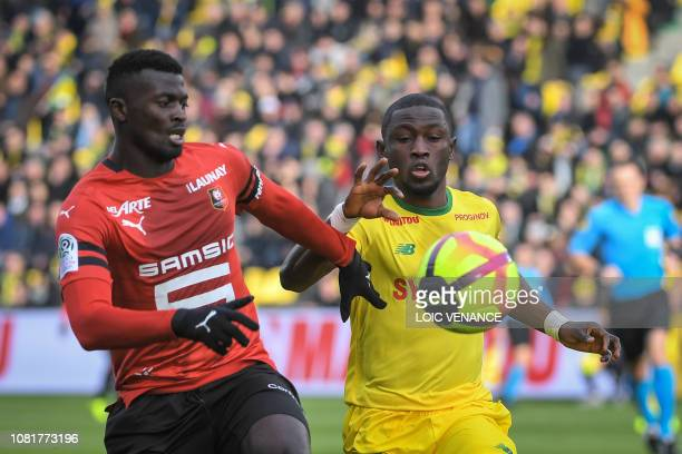 Rennes' Senegalese forward M'Baye Niang vies with Nantes' Ghanean forward Majeed Waris during the French L1 football match between Nantes and Rennes...