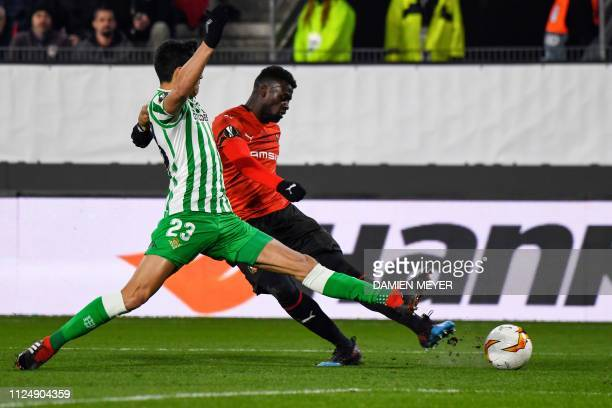 Rennes' Senegalese forward Mbaye Niang vies with Real Betis' Algerian defender Aissa Mandi during the UEFA Europa League round of 32 firstleg...