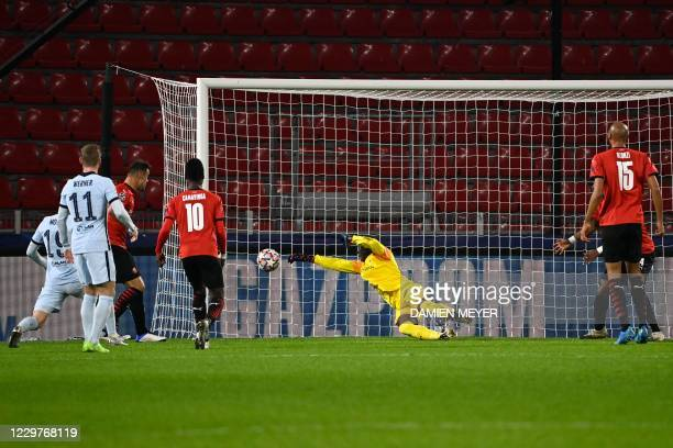 Rennes' Senegalese goalkeeper Alfred Gomis jumps to catch the ball during the UEFA Champions League Group E football match between Stade Rennais FC...
