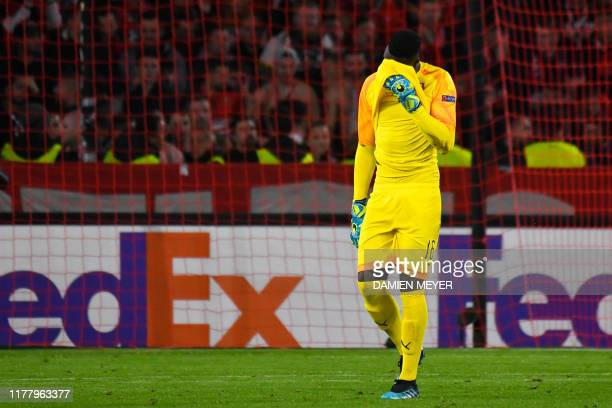Rennes' Senegalese goalkeeper Edouard Mendy reacts as he leaves the pitch after receiveing a red card during the Europa League Group E football match...