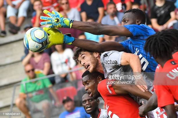 Rennes' Senegalese goalkeeper Edouard Mendy tries to catch the ball during the French L1 football match between Stade Rennais and Nice, on September...
