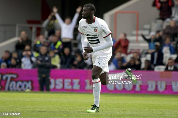Rennes Senegalese midfielder MBaye Niang celebrates after scoring a goal during the French L1 football match between Toulouse and Rennes on May 5...