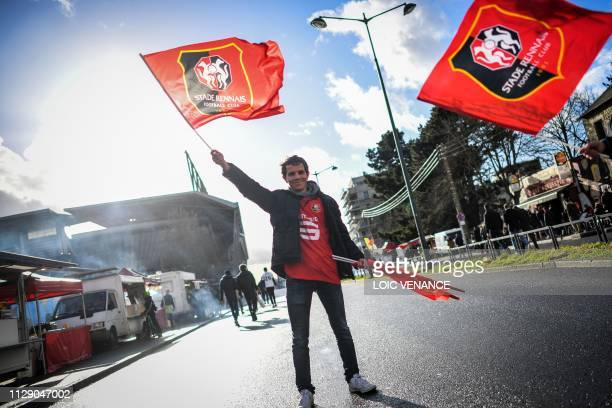A Rennes' supporter cheers in front of the Roazhon park stadium a few hours prior to the UEFA Europa League round of 16 first leg football match...