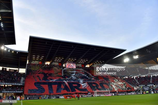 Rennes supporters cheer prior to the French L1 football match between Rennes and Paris Saint Germain on December 16 at the Roazhon Park in Rennes...