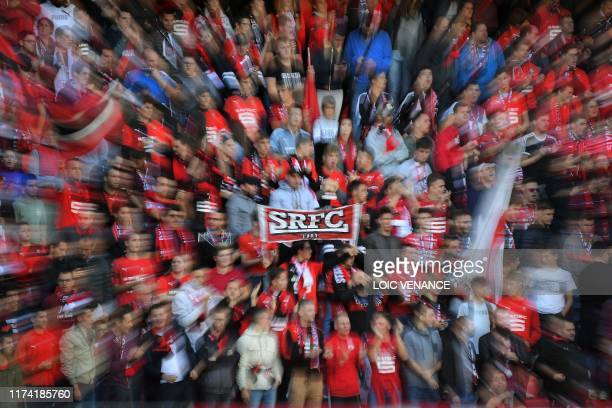 Rennes' supporters cheer their team during the French L1 Football match between Stade Rennais Football Club and Stade de Reims at the Roazhon Park,...