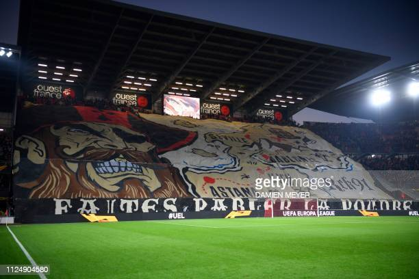 Rennes' supporters unveil a giant tifo before the UEFA Europa League round of 32 firstleg football match between Rennes and Real Betis at the Roazhon...