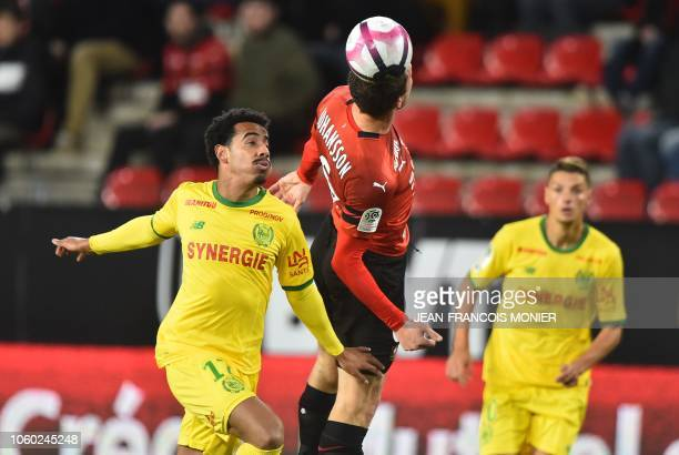 Rennes' Swedish midfielder Jakob Johansson vies with Nantes' Brazilian midfielder Lucas Evangelista and Nantes' Argentine forward Emiliano Sala...