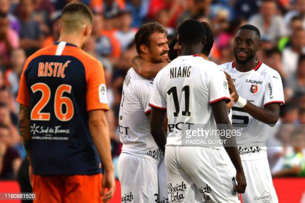 Rennes' team players react after Rennes' French defender Jeremy Morel scored a goal during the French L1 football match between Montpellier and...