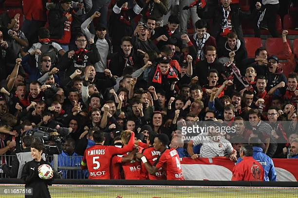 Rennes' teanmmates congratulate French forward Adama Diakhaby after scoring a goal during the French L1 football match Rennes against Guingamp on...