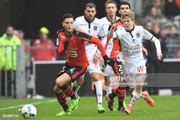 Rennes'Algeria defender Ramy Bensebaini vies for the ball with Nice's French midfielder Vincent Koziello during the French L1 football match between...