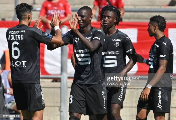 Rennes'players react after scoring a goal during the French L1 football match between Nimes and Rennes at the Costieres stadium in Nimes, southern...