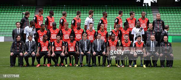 Rennes's players and staff pose at the route de Lorient stadium in Rennes western France on September 19 2013 First row seated Laurent Huard Michel...
