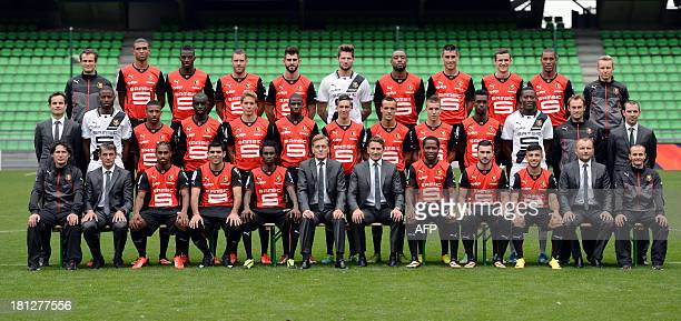 Rennes's players and staff pose for at the route de Lorient stadium in Rennes west of France on September 19 2013 First row seated Laurent Huard...