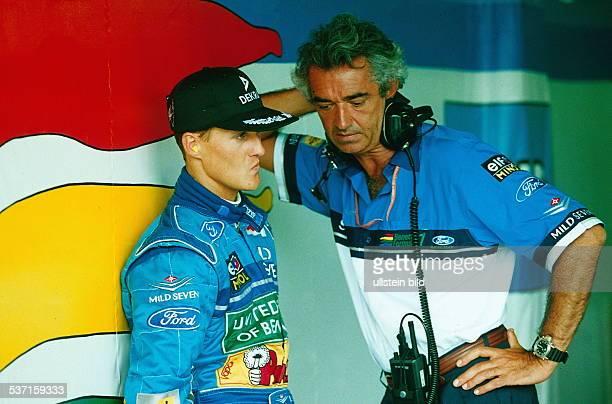 Rennfahrer Formel1 D mit seinem Rennleiter Flavio Briatore dem Teamchef von BenettonFord März 1994
