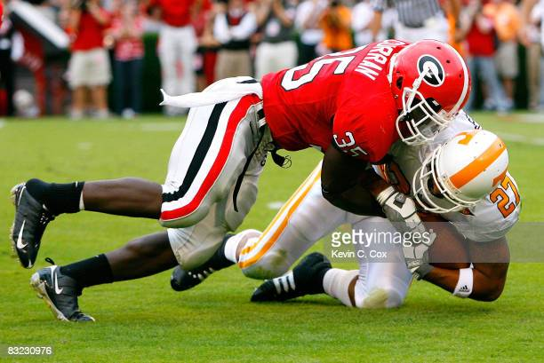 Rennie Curran of the Georgia Bulldogs tackles Arian Foster of the Tennessee Volunteers for a loss on third down during the game at Sanford Stadium on...