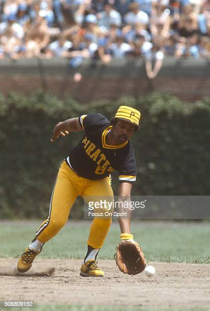 Rennie Stennett of the Pittsburgh Pirates goes down to field a ground ball against the Chicago Cubs during an Major League Baseball game circa 1979...