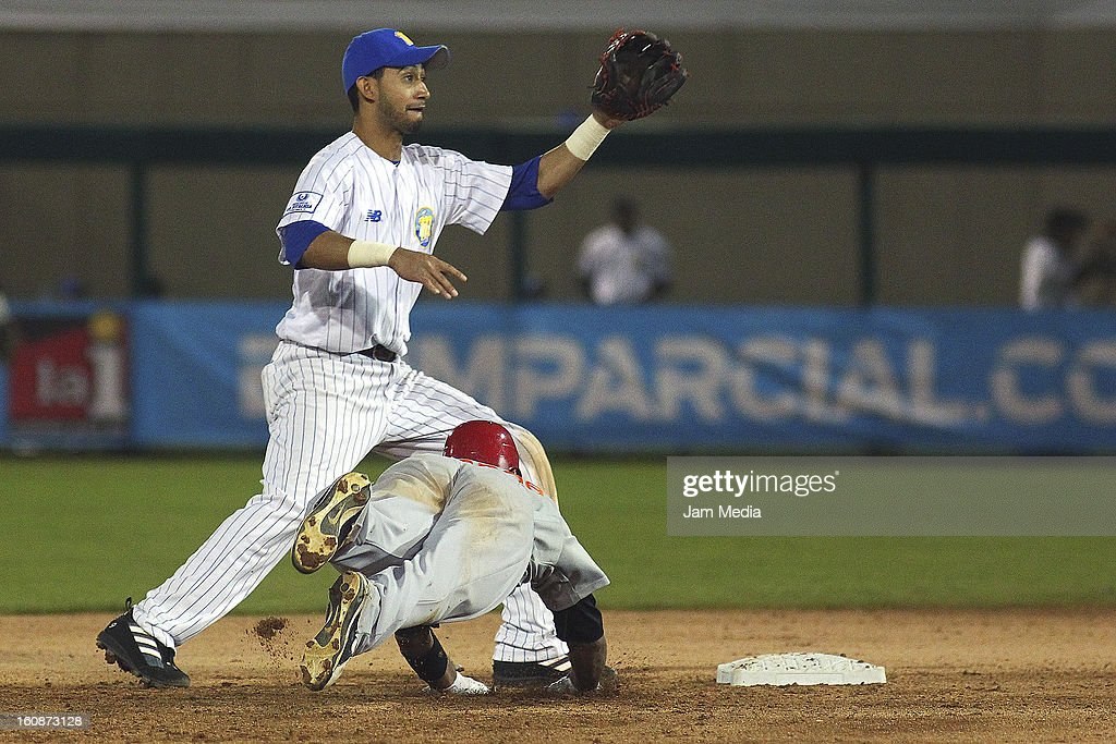 Renny Osuna of Venezuela and Luis Jimenez of Republica Dominicana in action during a match between Republica Dominicana and Venezuela as part of the Caribbean Series 2013 at Sonora Stadium on february 06, 2013 in Hermosillo, Mexico.
