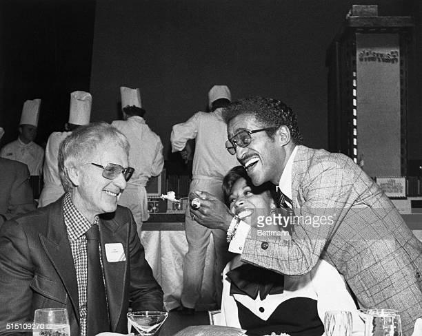 Reno, Nevada: Sammy Davis Jr. Offers cake to Bill Harrah, from an exact replica of Harrah's 250-room, $27 million hotel-casino. Davis acted as a...