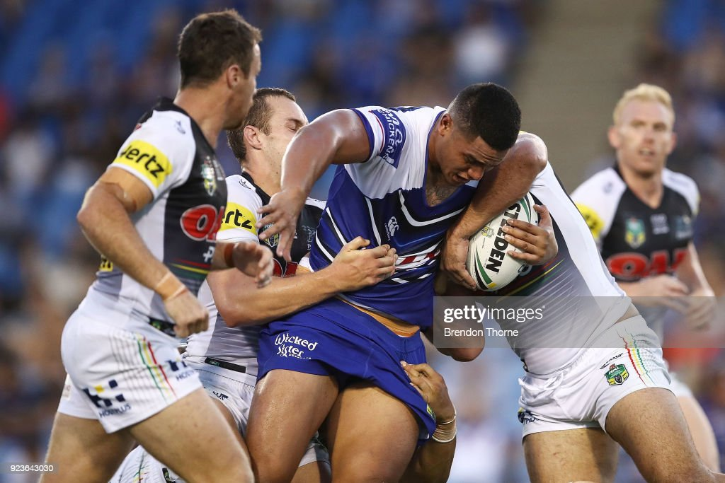 Renouf To'omaga of the Bulldogs is tackled by the Panthers defence during the NRL trial match between the Penrith Panthers ands the Canterbury Bulldogs at Belmore Sports Ground on February 24, 2018 in Sydney, Australia.
