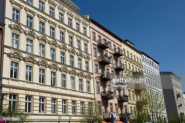 Renovated buildings are visible on Oderberger street in Berlin Germany
