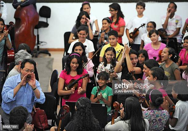 Renown cellist and Grammy winner YoYo Ma shouts to members of the Venezuelan National System of Youth and Children's Orchestra during a welcoming...