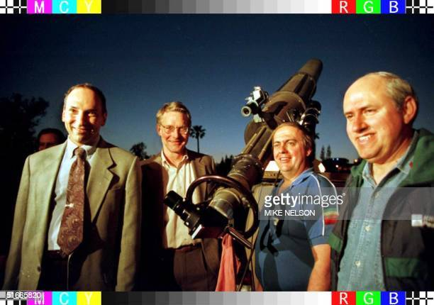 Renown comet hunters David Levy Dr Don Yeomans Dr Alan Hale and Thomas Bopp pose next to a telescope during a public viewing of the HaleBopp and...