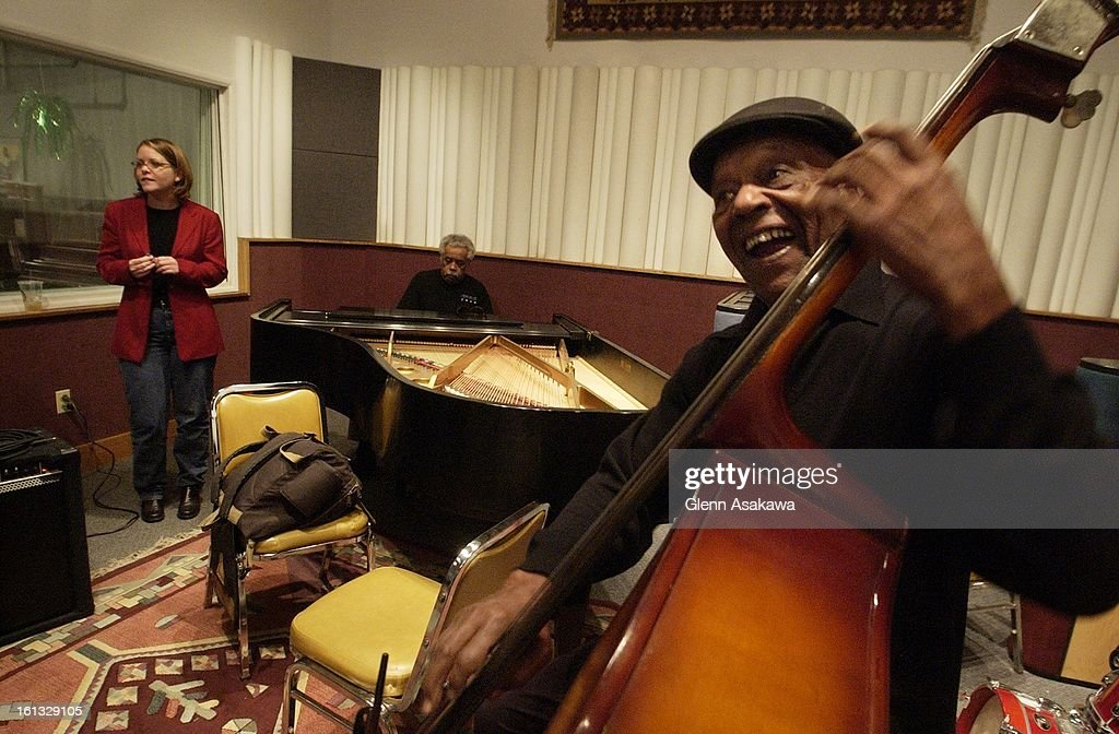 Renowned bassist Charles Burrell bangs out the bass with vocalist Monica Powell, left, and pianist Purnell Steen, center, in KUVO's live studio recently. The station, located at 2900 Welton in Denver, is one of a few still devoted wholeheartedly to jazz-e : News Photo