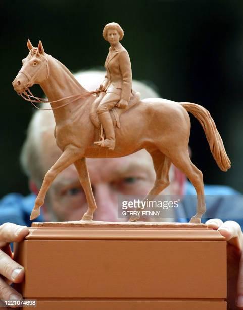 Renowned British artist Philip Jackson views his maquette of the statue of Britain's Queen Elizabeth II on horse back at his studio in Midhurst...