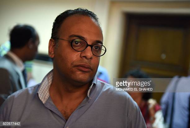 Renowned human rights activist Hossam Bahgat looks on as an Egyptian court examines a request to issue a travel ban and freeze the assets of him and...
