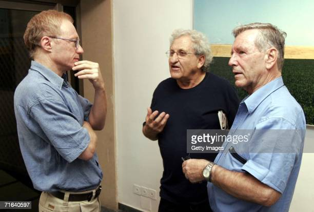 Renowned Israeli novelist and left-wing peace activist David Grossman talks with fellow Israeli writers A.B. Yehoshua and Amos Oz as they attend a...