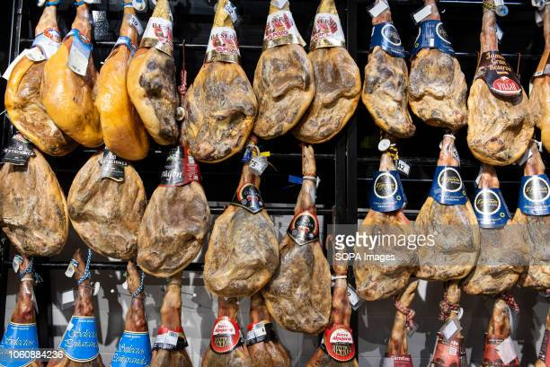 Renowned Spanish ham jamon are seen displayed for sale at a Carrefour supermarket in Spain