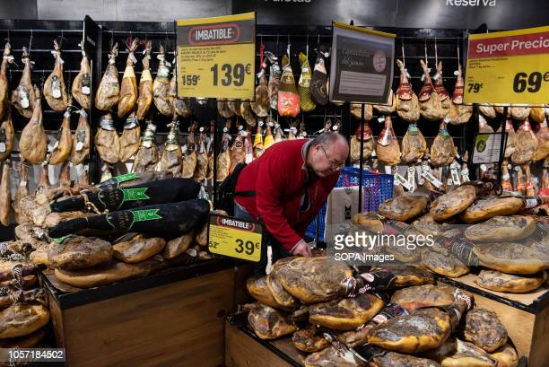 Renowned Spanish ham jamon are seen displayed for sale at the Carrefour supermarket in Spain