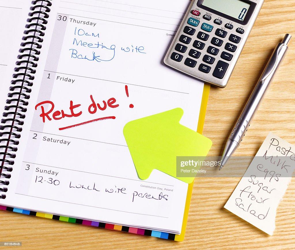 Rent due deadline in diary : Stock Photo