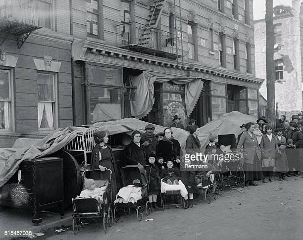 Rent Strikers evicted by landlord shown with their furnishings piled up on the sidewalk